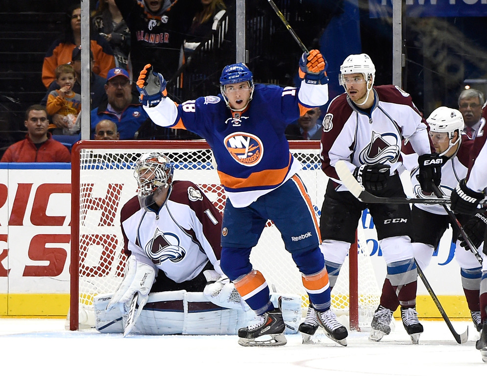 . New York Islanders center Ryan Strome (18) celebrates his goal as Colorado Avalanche goalie Semyon Varlamov (1) and defenseman Zach Redmond (22) react in the third period of an NHL hockey game at Nassau Coliseum on Tuesday, Nov. 11, 2014, in Uniondale, N.Y. The Islanders won 6-0. (AP Photo/Kathy Kmonicek)