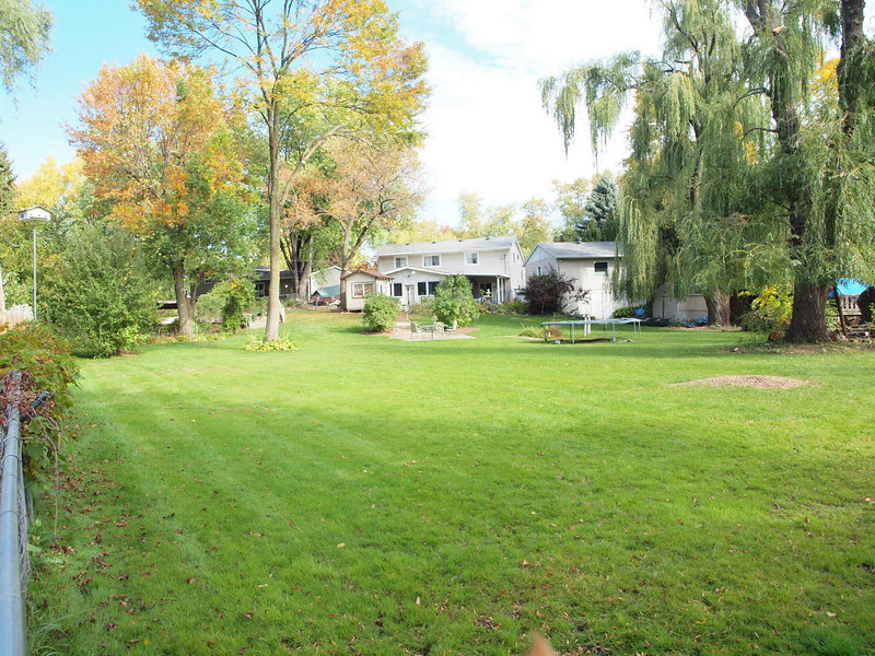 Largest lot in Grandwood Park - AND on the water! Storage galore!! Have you ever seen a garage with an English basement!!