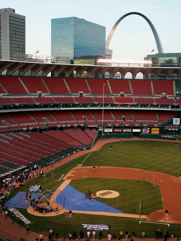 . The setting sun reflects off the Gateway Arch above Busch Stadium in St. Louis as the Boston Red Sox hold a team workout Monday, Oct. 25, 2004, in St. Louis. The Red Sox come into St. Louis for Game 3 of the World Series leading the Cardinals 2-0. (AP Photo/Al Behrman)