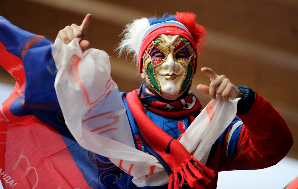 . A fan wait for the start of the men\'s two-man bobsled competition at the 2014 Winter Olympics, Monday, Feb. 17, 2014, in Krasnaya Polyana, Russia. (AP Photo/Jae C. Hong)