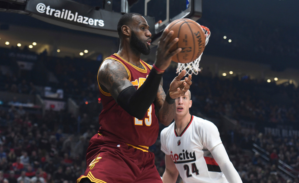 . Cleveland Cavaliers forward LeBron James passes the ball as Portland Trail Blazers center Mason Plumlee defends during the first half of an NBA basketball game in Portland, Ore., Wednesday, Jan. 11, 2017. (AP Photo/Steve Dykes)