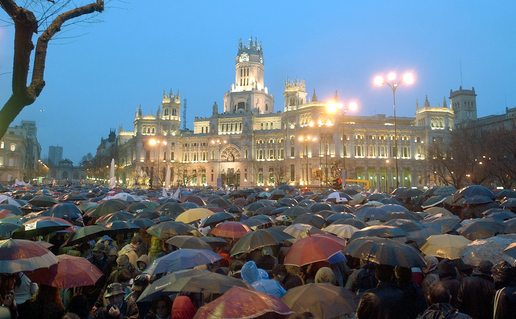 . Hundreds of thousands of people fill the central Cibeles square in Madrid Friday March 12, 2004, during a demonstration to protest the numerous attacks on trains in the Spanish capital that killed nearly 200 people and injured at least another 1,400. (AP Photo/Peter Dejong)
