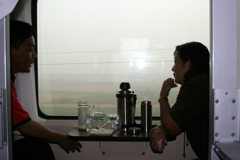 Tea break together.. Qinghai -Beijing to Tibet Railway, Beijing to Lhasa  Oct  2006