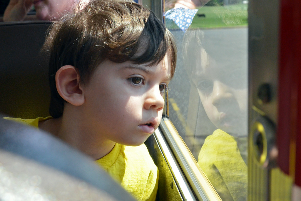 . Kindergartner Hunter Murphy looks out the window during his school bus ride on K Day.     Thursday, August  7. 2014.   Photo by Geoff Patton