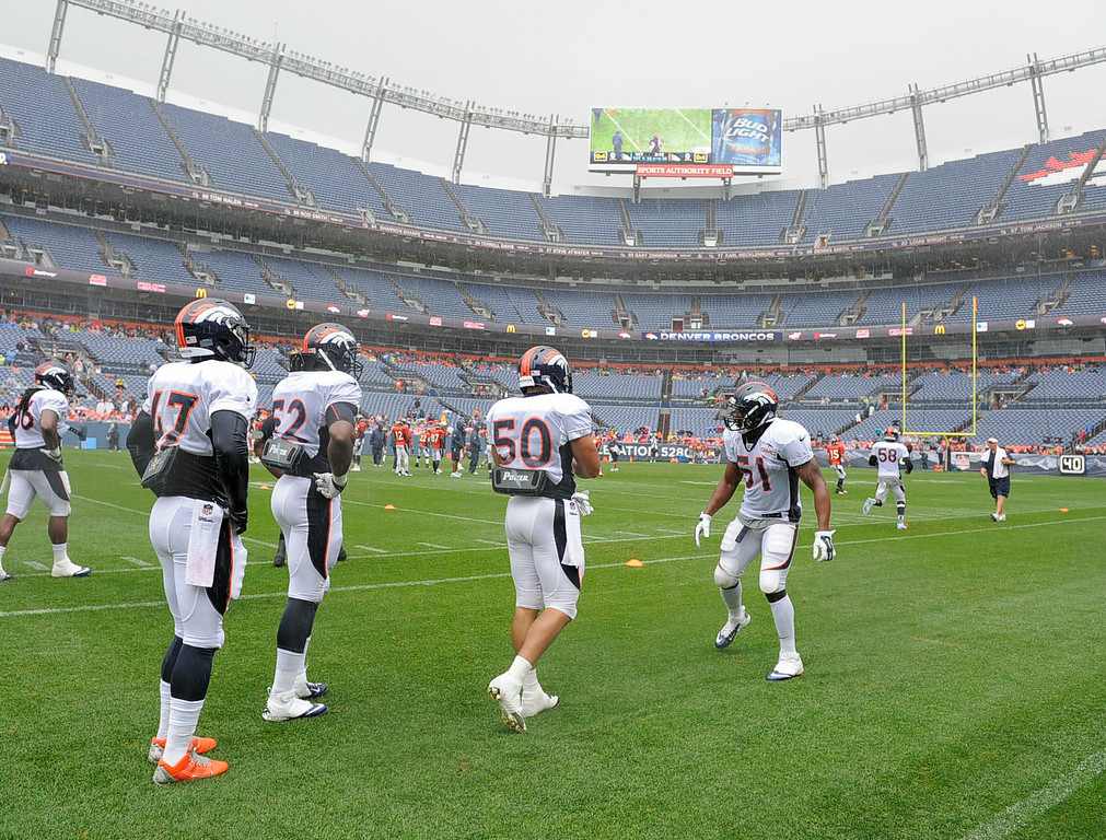 . The Denver Broncos practiced in the rain on day six of the Denver Broncos 2014 training camp July 30, 2014 at Sports Authority Field at Mile High Stadium.  (Photo by John Leyba/The Denver Post)