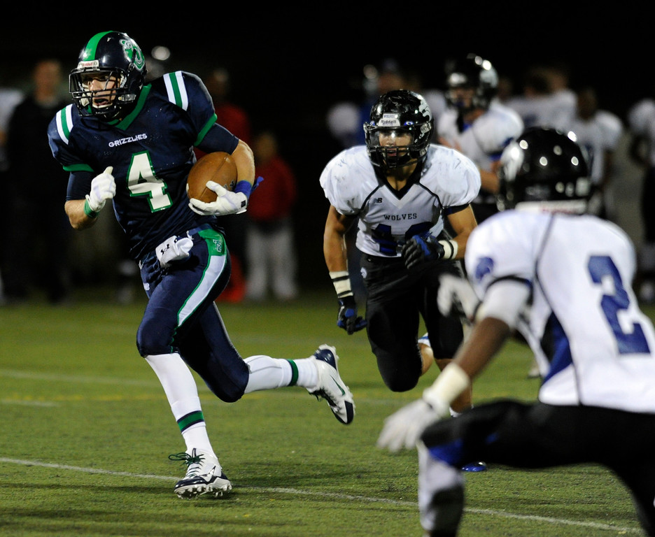 . HIGHLANDS RANCH, CO. - SEPTEMBER 13: Grizzlies receiver Mark Hopper (4) sprinted away from Wolves\' defenders in the second half. The ThunderRidge High School football team defeated Grandview 21-7 at Shea Stadium Friday night, September 13, 2013.  Photo By Karl Gehring/The Denver Post