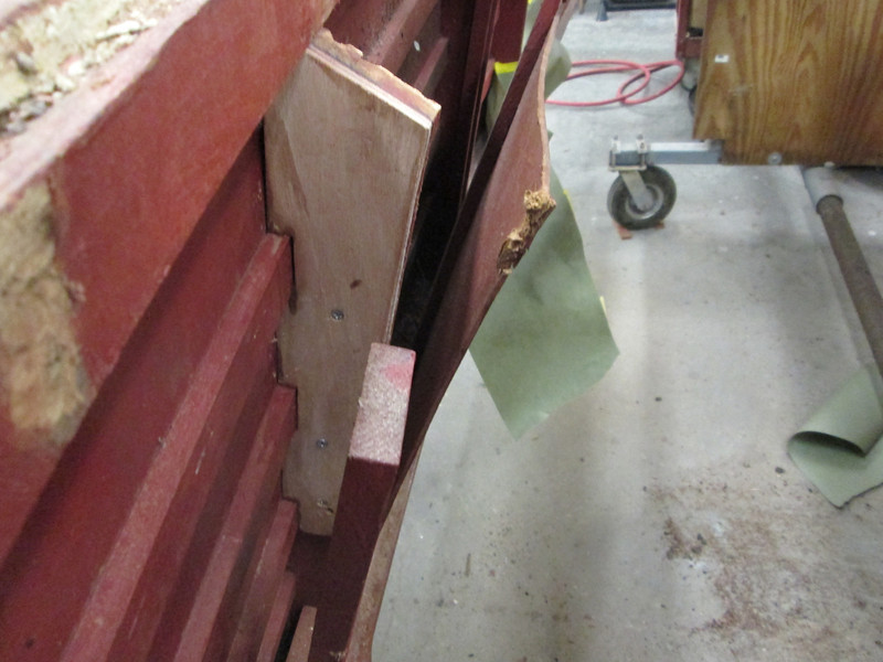 Repaired the side frame by adding a plywood doubler and epoxying it in place.