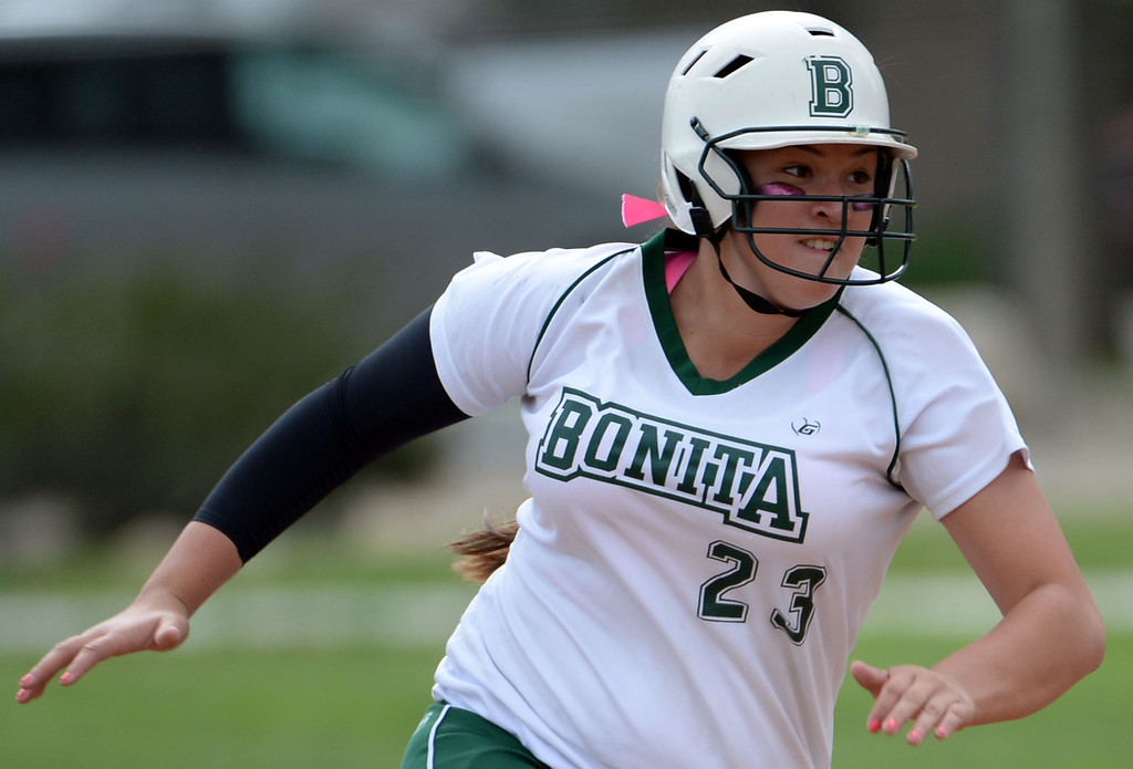 . Bonita\'s Veronica Ortega moves to third base on a single by Kaelyn Mc Fadden (not pictured) in the first inning of a prep softball game against West Covina at Los Flores Park in La Verne, Calif., on Thursday, March 27, 2014. Bonita won 6-3. (Keith Birmingham Pasadena Star-News)
