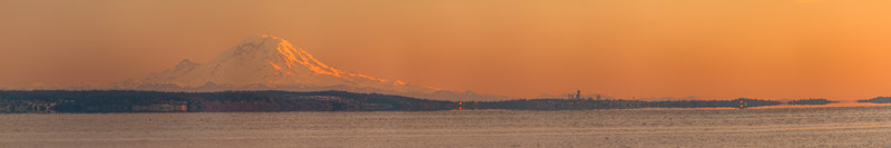Panoramic image of Mt. Rainier and Seattle from across Puget Sound on Whidbey Island, Washington, USA.
