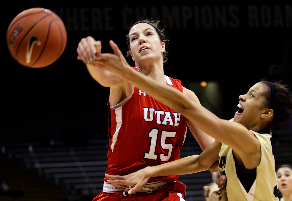 . Utah\'s Michelle Plouffe (15) blocks a shot by Colorado\'s Arielle Roberson during the first half of their NCAA college basketball game, Tuesday, Jan. 8, 2013, in Boulder, Colo. (AP Photo/Brennan Linsley)