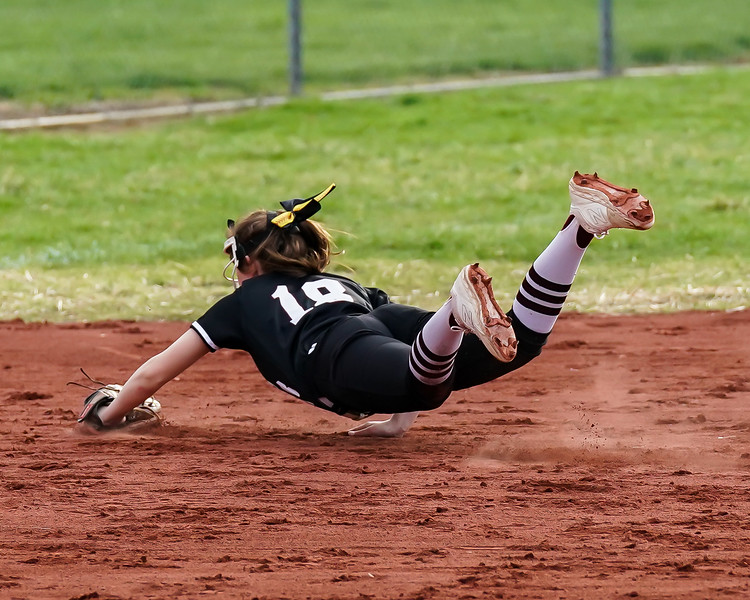 Wellington Tori Paramore makes the diving stop against Brookside Wednesday April 17.  photo Joe Colon