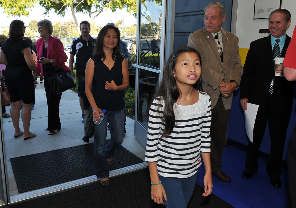 . 8/21/13 - Students, parents, faculty and community members gathered Wednesday morning for the grand opening of Ambassador High School, the second non-Catholic, Christian high school in the South Bay. Located in the LA Galaxy training center the school is starting with 25 students. Mikaela Licudine, 12, is home schooled in Mar Vista but hopes to attend Ambassador in the future, following in her brothers footsteps. Photo by Brittany Murray, Daily Breeze