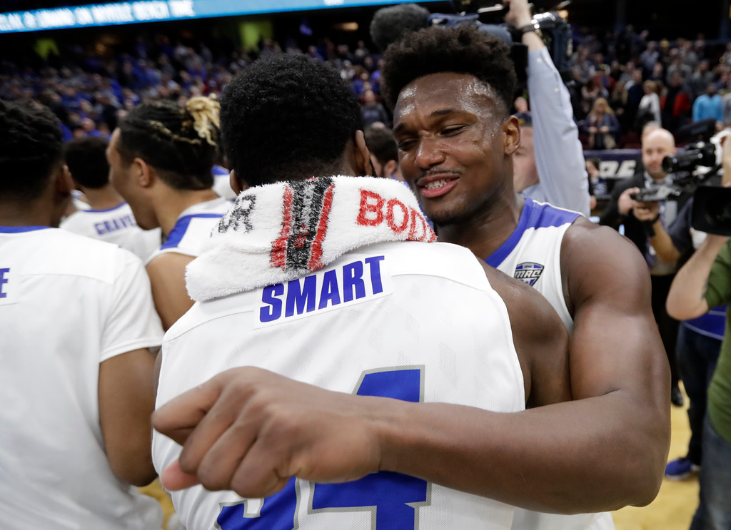 . Buffalo\'s Nick Perkins, right, hugs Ikenna Smart after Buffalo defeated Toledo 76-66 in an NCAA college basketball championship game of the Mid-American Conference tournament, Saturday, March 10, 2018, in Cleveland. (AP Photo/Tony Dejak)