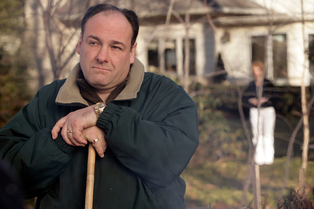 """. FILE - This file photo released by HBO in 2007 shows James Gandolfini as Tony Soprano in a scene from one of the last episodes of the HBO dramatic series \""""The Sopranos.\"""" HBO and the managers for Gandolfini say the actor died Wednesday, June 19, 2013, in Italy. He was 51.  (AP Photo/HBO, Craig Blankenhorn, File)"""