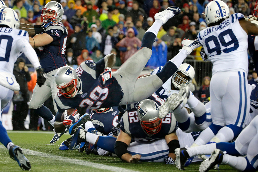 . New England Patriots running back LeGarrette Blount (29) dives into the end zone for a touchdown during the first half of an AFC divisional NFL playoff football game against the Indianapolis Colts in Foxborough, Mass., Saturday, Jan. 11, 2014. (AP Photo/Matt Slocum)