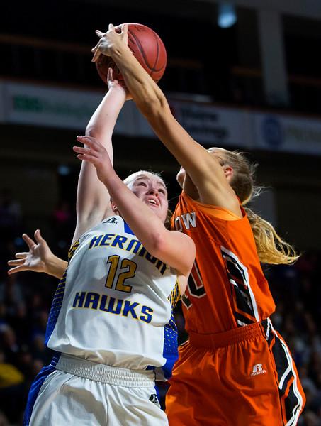 BANGOR, Maine -- 02/18/2017 -- Winslow's Ciara LeClair (right) fouls Hermon's Madisyn Curtis during their Class B girls basketball quarterfinal game at the Cross Insurance Center in Bangor Saturday. Ashley L. Conti | BDN