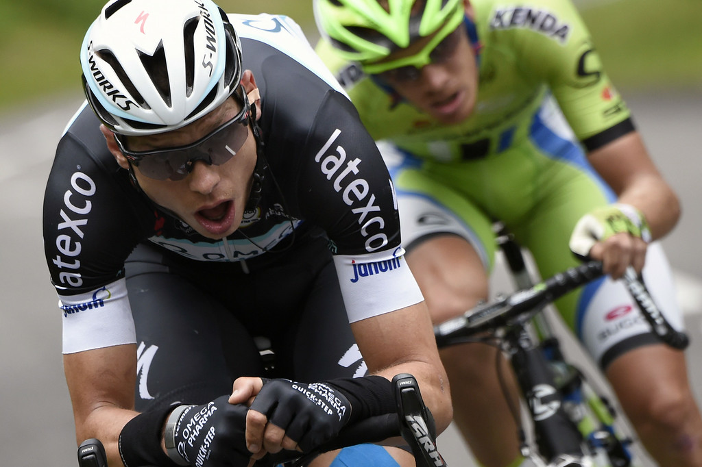 . Germany\'s Tony Martin (L) and Italy\'s Alessandro De Marchi ride in a breakaway during the 170 km ninth stage of the 101st edition of the Tour de France cycling race on July 13, 2014 between Gerardmer and Mulhouse, eastern France.  AFP PHOTO / ERIC FEFERBERGERIC FEFERBERG/AFP/Getty Images