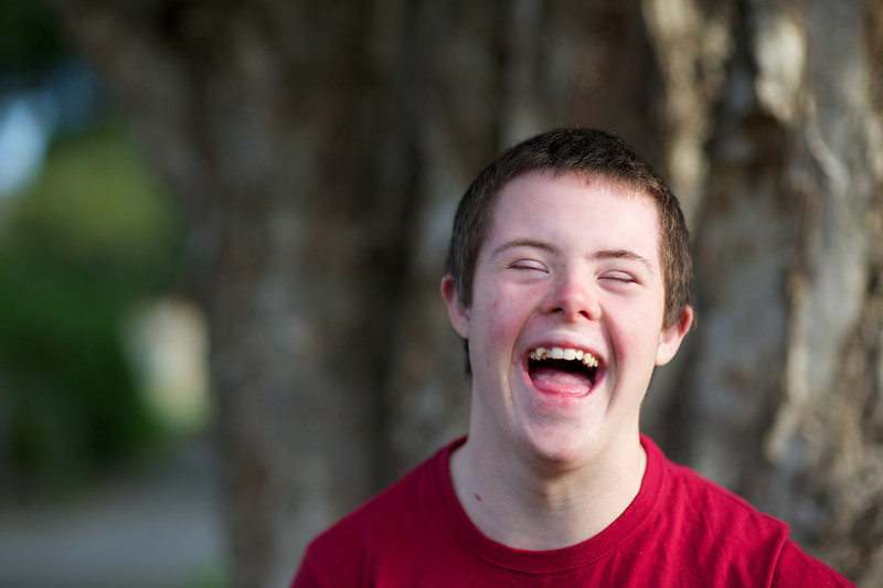 Laughing Teenage Boy photographed Outdoors