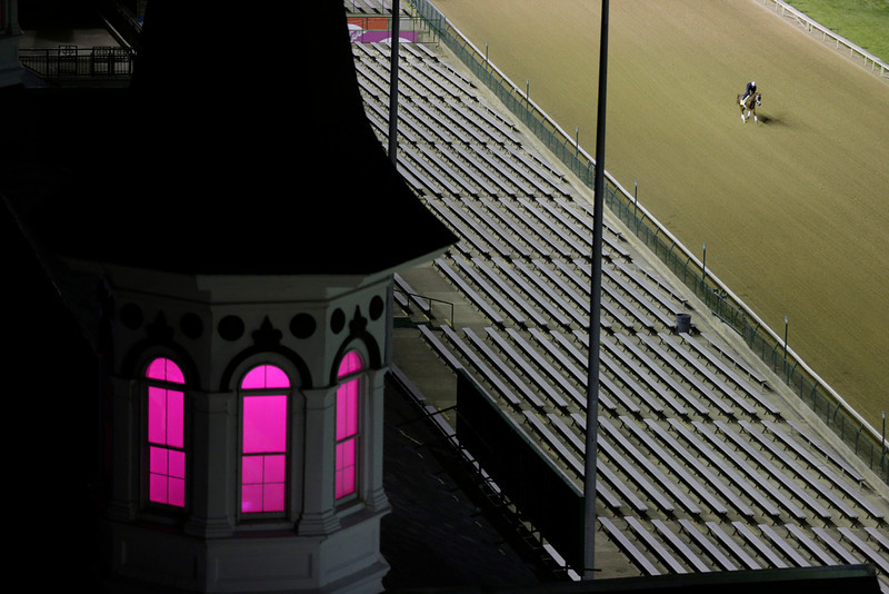 . Exercise rider Ezequiel Perez takes Kentucky Derby entrant Danza for a morning workout during a morning workout at Churchill Downs Friday, May 2, 2014, in Louisville, Ky. (AP Photo/Charlie Riedel)
