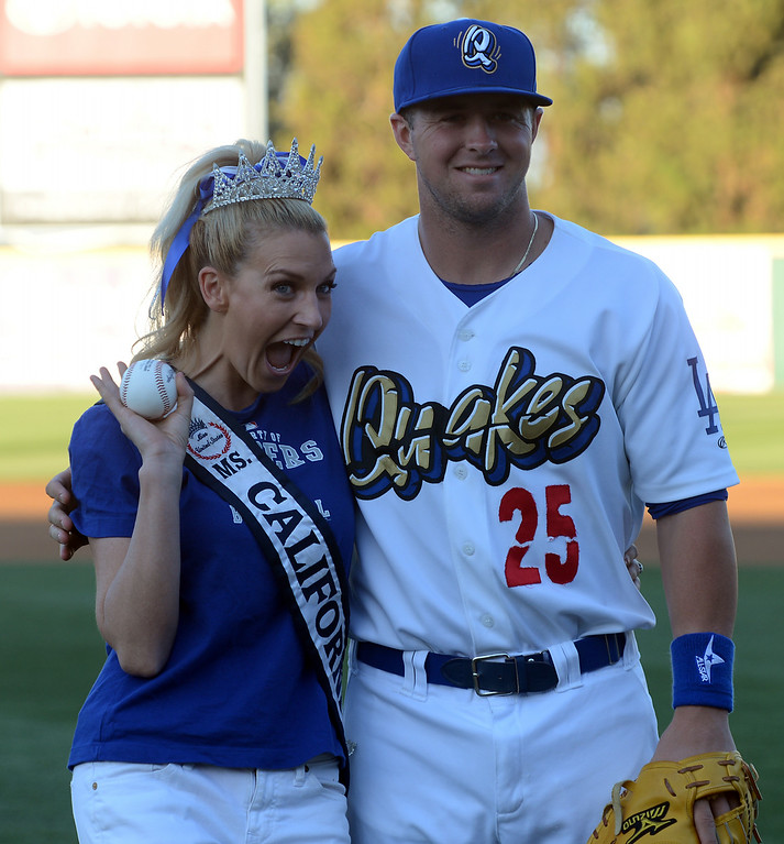 . Ms. California 2014 Sande Charles poses with a Quakes player after throwing out the first pitch before the Quakes game at LoanMart Field in Rancho Cucamonga, CA, Friday, August 15, 2014. (Photo by Jennifer Cappuccio Maher/Inland Valley Daily Bulletin)