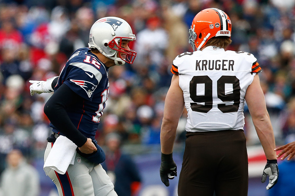. Tom Brady #12 of the New England Patriots reacts after being sacked in front of Paul Kruger #99 of the Cleveland Browns during the game at Gillette Stadium on December 8, 2013 in Foxboro, Massachusetts.  (Photo by Jared Wickerham/Getty Images)
