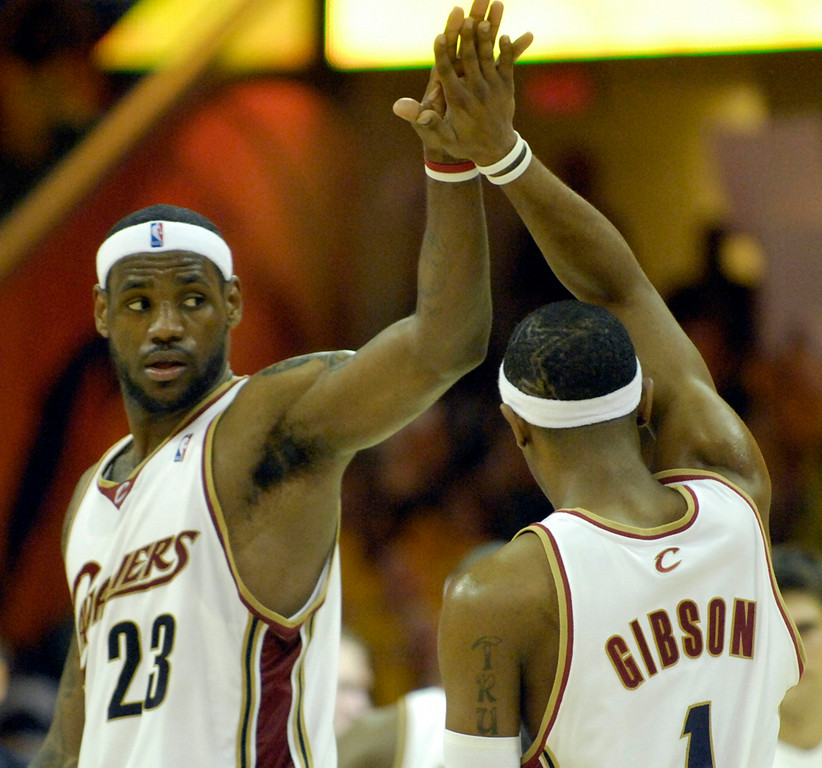 . LeBron James congratulates teammate Daniel Gibson after Gibson\'s scoring drive in the second half of Monday\'s game against the Wizards.
