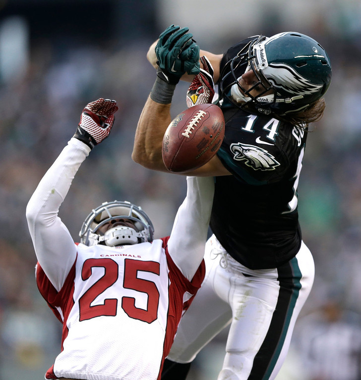 . Philadelphia Eagles\' Riley Cooper, right, is unable to catch a pass as Arizona Cardinals\' Jerraud Powers defends during the second half of an NFL football game, Sunday, Dec. 1, 2013, in Philadelphia. (AP Photo/Matt Rourke)