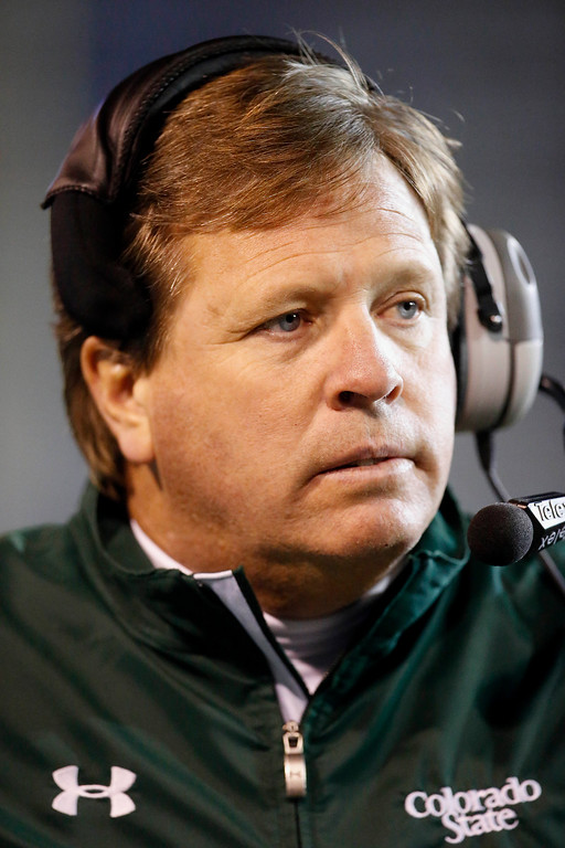 . Colorado State head coach Jim McElwain walks the sideline during the second half against San Jose State in an NCAA college football game Saturday, Nov. 1, 2014, in San Jose, Calif. Colorado State won 38-31. (AP Photo/Tony Avelar)
