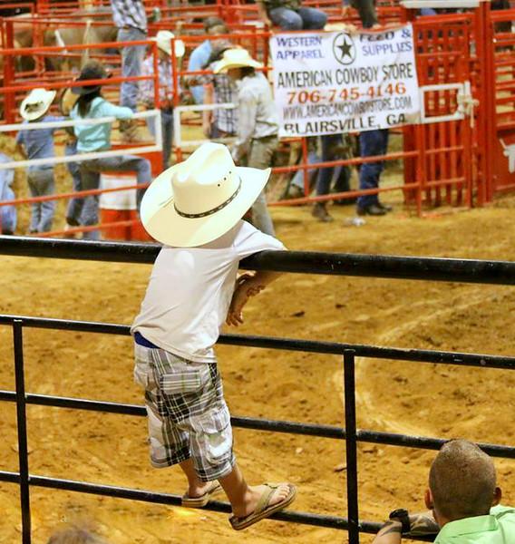 cowboy kid on rail.jpg