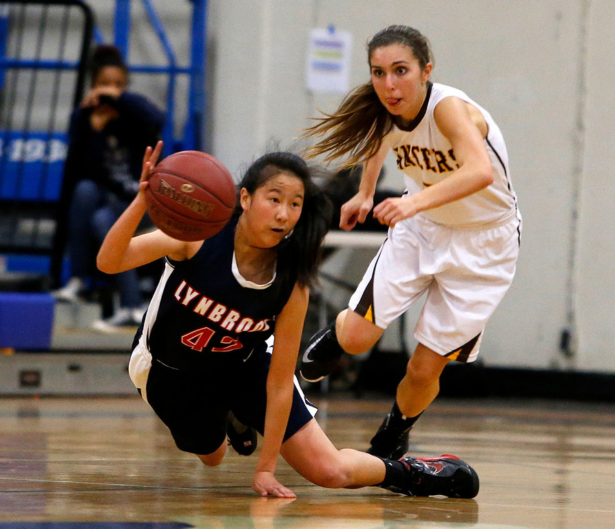 . Lynbrook High School\'s Dolly Yuan (42) passes the ball off against St. Francis High School\'s Shelbi Aimonetti (3) in the fourth period for the CCS Open Division Girls Basketball semifinals at Oak Grove High School in San Jose, Calif., on Wednesday, Feb. 27, 2013.  St. Francis High School won 37-27.  (Nhat V. Meyer/Staff)