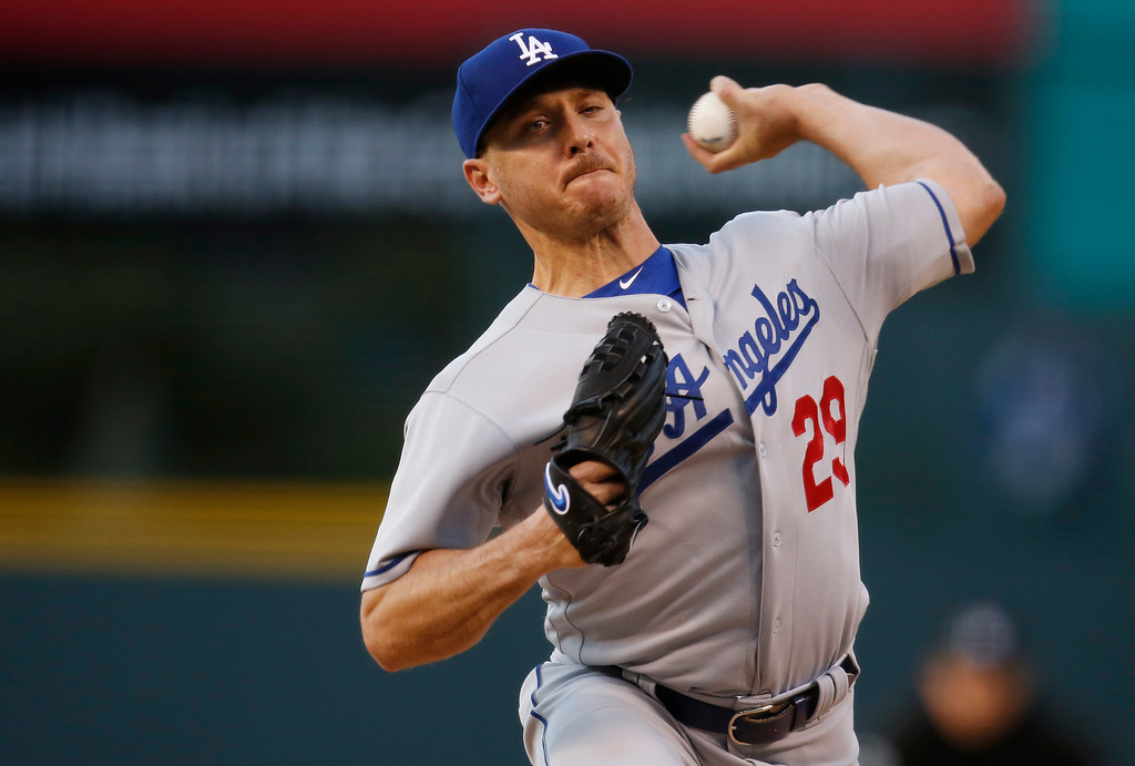 . Los Angeles Dodgers starting pitcher Scott Kazmir delivers to Colorado Rockies\' Carlos Gonzalez in the first inning of a baseball game Friday, April 22, 2016, in Denver. (AP Photo/David Zalubowski)