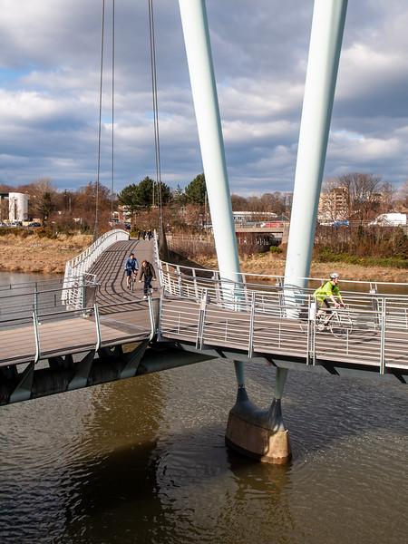 Cycling on Lancaster Millennium Bridge