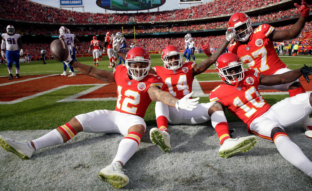 . Kansas City Chiefs wide receiver Albert Wilson (12), wide receiver Demarcus Robinson (14), wide receiver Tyreek Hill (10) and running back Kareem Hunt (27) pose for photographers after Wilson scored a touchdown against the Buffalo Bills during the second half of an NFL football game in Kansas City, Mo., Sunday, Nov. 26, 2017. (AP Photo/Charlie Riedel)