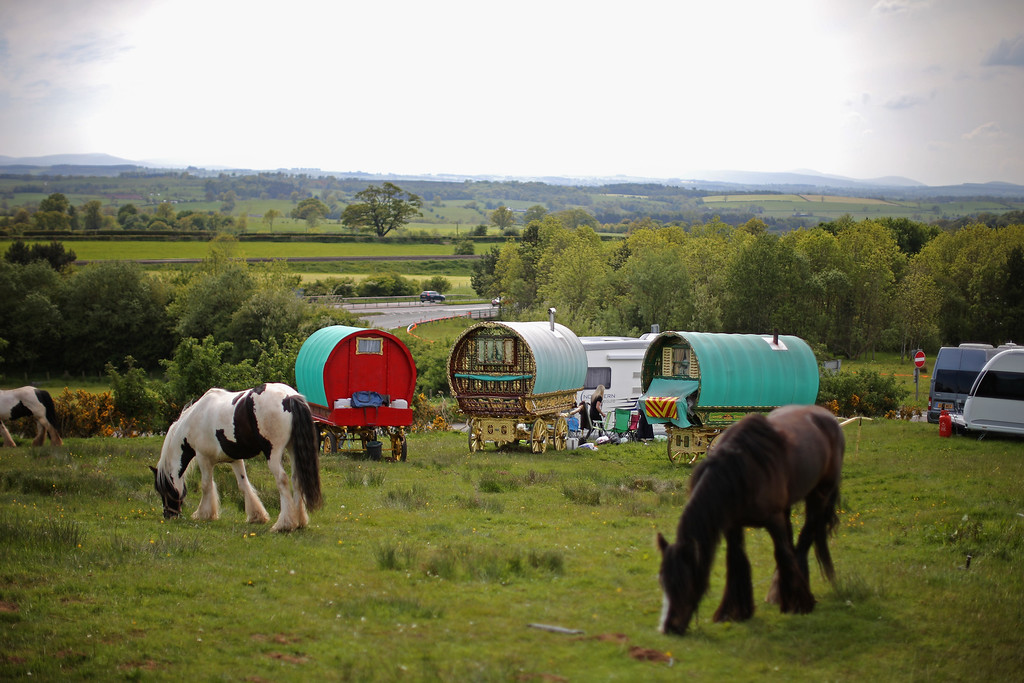 . Traditional romany caravans camp on Fair Hill during the Appleby Horse Fair on June 4, 2015 in Appleby, England. The Appleby Horse Fair has existed under the protection of a charter granted by James II since 1685 and is one of the key gathering points for the Romany, gypsy and traveling community. The fair is attended by about 5,000 travelers who come to buy and sell horses. The animals are washed and groomed before being ridden at high speed along the \'mad mile\' for the viewing of potential buyers.  (Photo by Christopher Furlong/Getty Images)