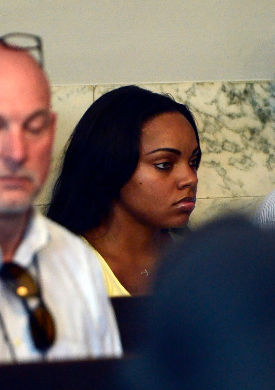 . The girlfriend of Former New England Patriots tight end Aaron Hernandez, Shayanna Jenkins, sits in the courtroom while Hernandez appears in Attleboro District Court to face murder charges in relation to the death of a friend, in Attleboro, Massachusetts, USA 26 June 2013. Hernandez was arrested at his home earlier in the day. The body of 27-year-old Odin Lloyd, an acquaintance of Hernandez, and a semi-pro football player, was found 17 June 2013 in an industrial area about 1 mile (1.6 km) from the home of Hernandez.  EPA/MIKE GEORGE/SUN CHRONICLE/POOL
