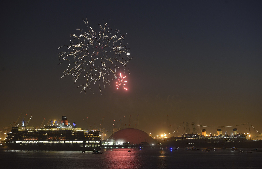 . LONG BEACH, CALIF. USA -- The youngest Cunard Line ship, Queen Elizabeth, left, visits the Queen Mary, in Long Beach (Calif.) Harbor on March 12, 2013. The Queen Mary was built by Cunard in 1936 and retired in 1967. The Queen Mary, now a permanently berthed, is a hotel and special events venue. The two ships exchanged whistle blows.   Photo by Jeff Gritchen / Los Angeles Newspaper Group