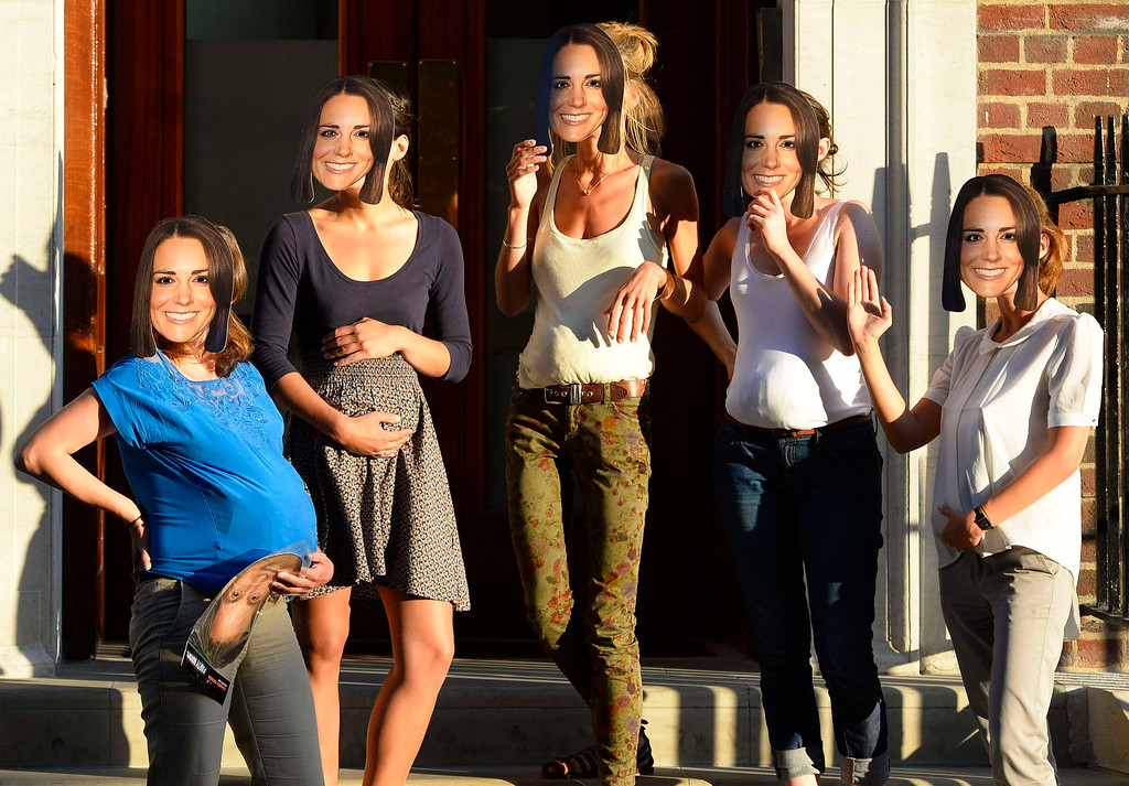 . A group of women pose with Duchess of Cambridge masks outside the Lindo Wing of St Mary\'s Hospital, where Britain\'s Catherine, Duchess of Cambridge is expected to give birth, in London July 18, 2013. The first child of Prince William and his wife Kate is due in July, with the couple saying they have no idea of the sex of the royal baby, who will be third in line to the British throne.     REUTERS/Paul Hackett