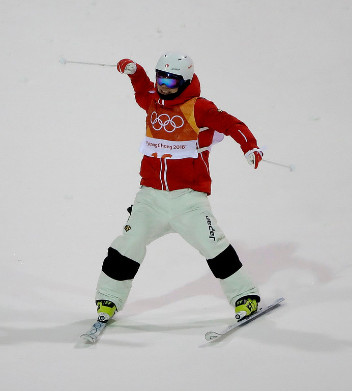 . Bronze medal winner Daichi Hara, of Japan, celebrates after the men\'s moguls qualifying at Phoenix Snow Park at the 2018 Winter Olympics in Pyeongchang, South Korea, Monday, Feb. 12, 2018. (AP Photo/Gregory Bull)