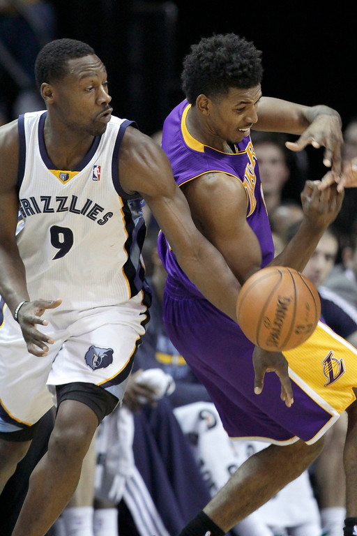 . Memphis Grizzlies\' Tony Allen (9) slaps the ball away from Los Angeles Lakers\' Nick Young during the second half of an NBA basketball game in Memphis, Tenn., Tuesday, Dec. 17, 2013. The Lakers defeated the Grizzlies 96-92. (AP Photo/Danny Johnston)
