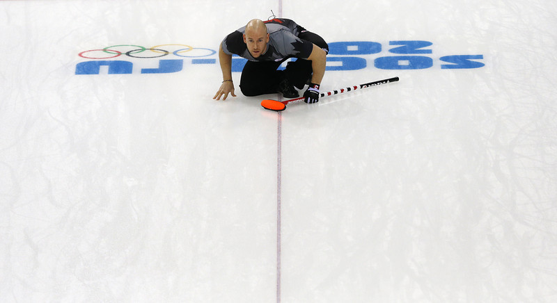 . Canada\'s Ryan Fry watches his stone during the men\'s curling round robin session 3 match between Sweden and Canada at the Ice Cube curling centre in Sochi on February 11, 2014 during the 2014 Sochi winter Olympics. (ADRIAN DENNIS/AFP/Getty Images)