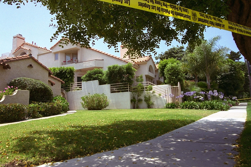. Police tape surrounds the Bundy Drive home of Nicole Brown Simpson, ex-wife of former NFL great O.J. Simpson after she was murdered late Sunday June 12, 1994.  The bodies of Nicole Brown and her friend Ron Goldman were found shortly after midnight. (AP Photo/Eric Draper)