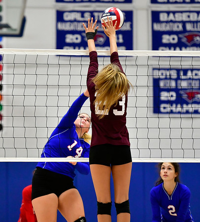 10/11/2019 Mike Orazzi | StaffrSt. Paul's Megan Fortier (14) and Torrington's Sydney Bermas (23) during Thursday night's girls volleyball match in Bristol. r
