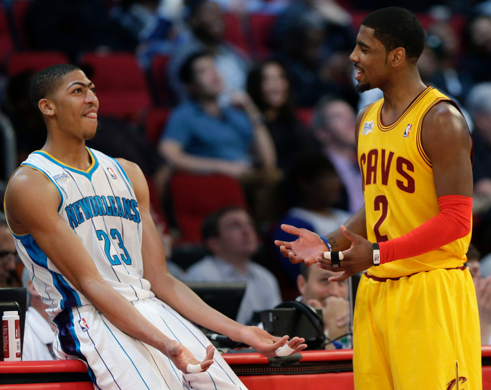 . Team Chuck\'s Anthony Davis of the New Orleans Hornets, left, and Team Shaq\'s Kyrie Irving of the Cleveland Cavaliers talk during the second half of the Rising Stars Challenge basketball game at NBA All-Star Weekend Friday, Feb. 15, 2013, in Houston. (AP Photo/Eric Gay)