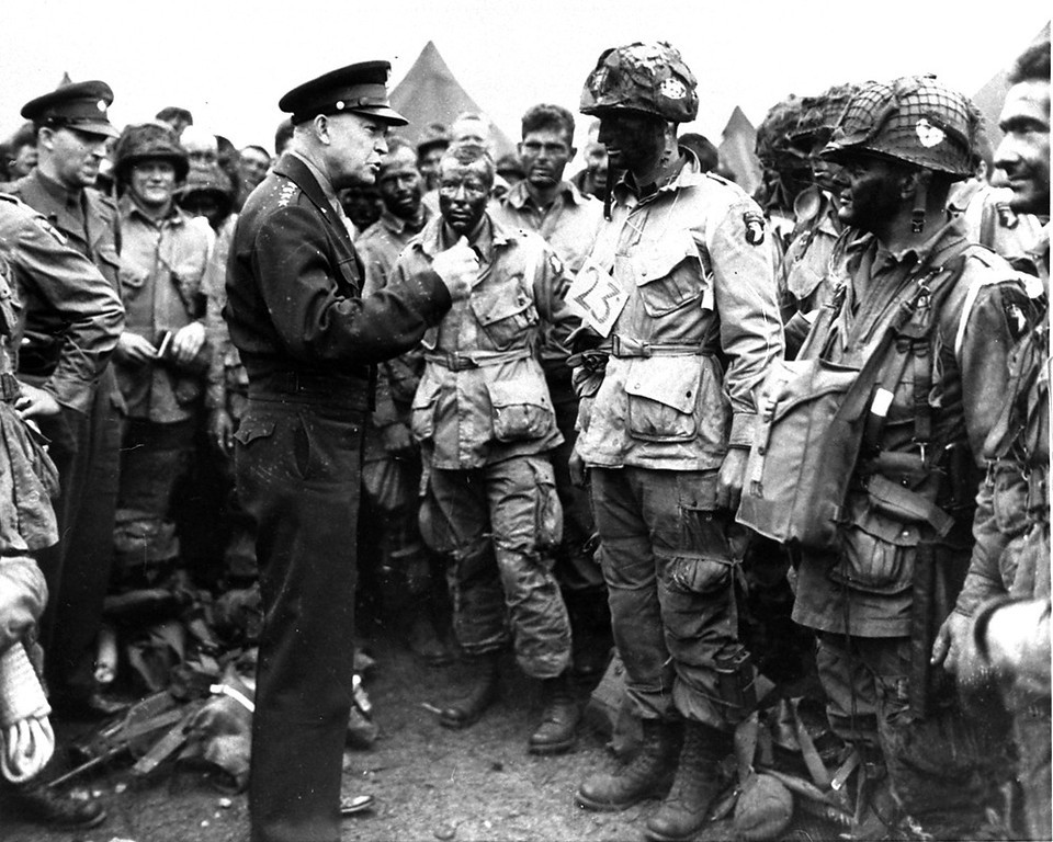 ". General Dwight D. Eisenhower gives the order of the day, ""Full victory - nothing else,\"" to paratroopers somewhere in England, just before they boarded their airplanes to participate in the first assault in the invasion of the continent of Europe, June 6, 1944.  (AP Photo/U.S. Army Signal Corps Photo)"