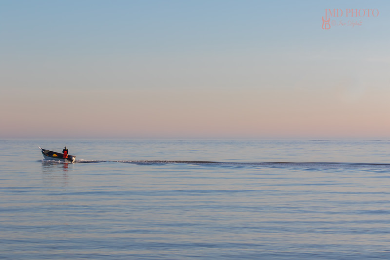 Solitude. Alone at sea. Small fishing boat on the ocean.