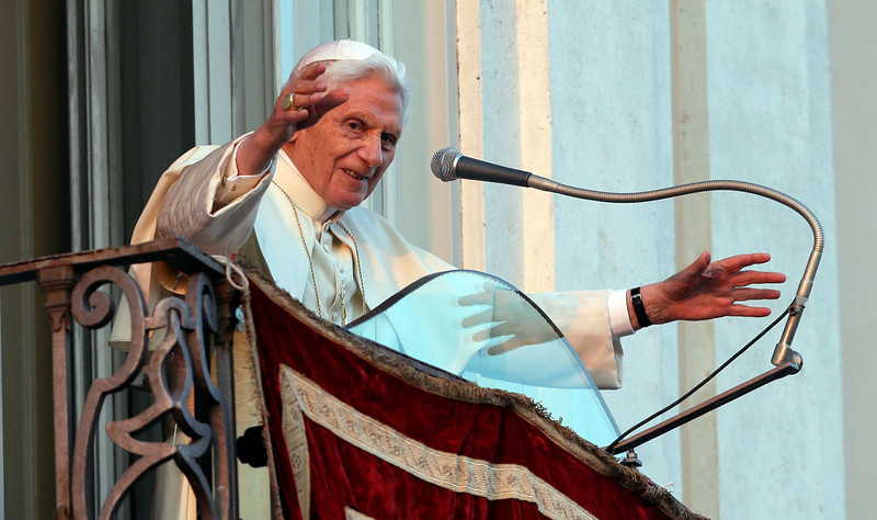 . Pope Benedict XVI greets faithful from his summer residence of Castel Gandolfo, the scenic town where he will spend his first post-Vatican days and made his last public blessing as pope,Thursday, Feb. 28, 2013. (AP Photo/Alessandra Tarantino)