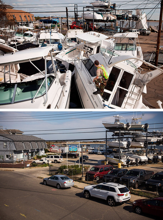 . HIGHLANDS, NJ - NOVEMBER 1:  (top) A volunteer surveys a pile of boats, which were moved by Superstorm Sandy, on November 1, 2012 in Highlands, New Jersey.   HIGHLANDS, NJ - OCTOBER 22:  (bottom)  Boats are stored at a marina in Highlands, New Jersey October 22, 2013.  Hurricane Sandy made landfall on October 29, 2012 near Brigantine, New Jersey and affected 24 states from Florida to Maine and cost the country an estimated $65 billion.   (Photos by Andrew Burton/Getty Images)