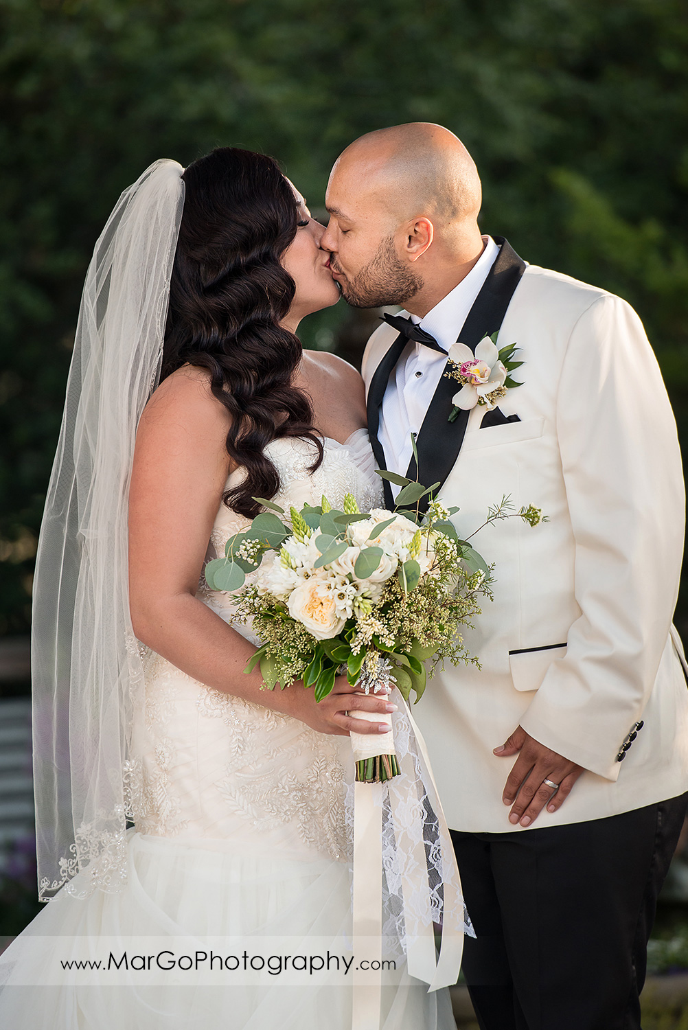 first kiss as husband and wife during wedding ceremony at Sunol's Casa Bella