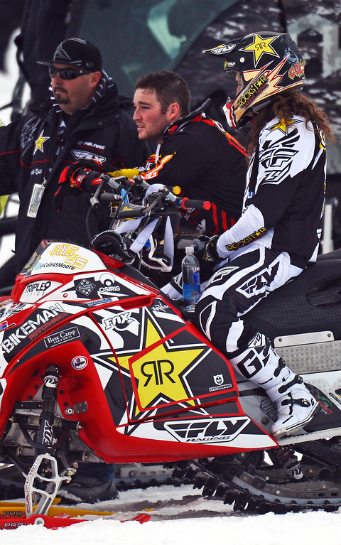 . Caleb Moore, center, watches practice for Snowmobile Freestyle, January 24, 2013, during the 2013 Winter X Games in Aspen. Freestyle snowmobile athlete Caleb Moore remains in intensive care with heart problems and now a brain complication after a horrible crash Thursday night in the Winter X Games.  (Photo By RJ Sangosti / The Denver Post)