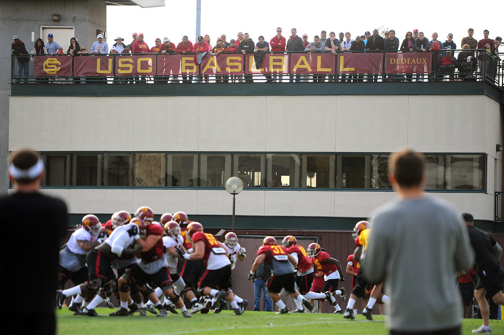 . People line the baseball stadium to watch the USC football practice, Tuesday, March 25, 2014, at USC. (Photo by Michael Owen Baker/L.A. Daily News)
